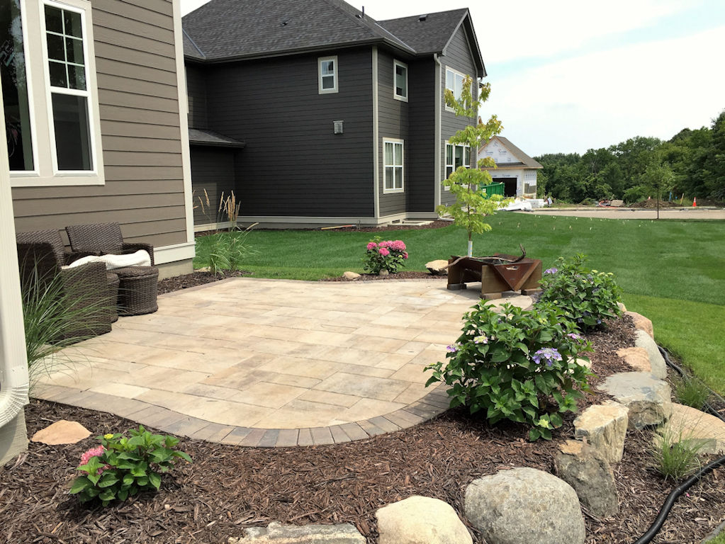 paver patio and elevated rock outcropping