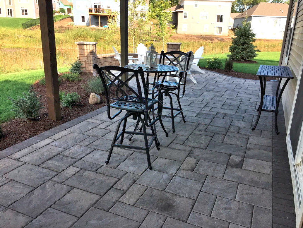 We designed this patio under the existing deck with a careful selection of stone and native plantings.