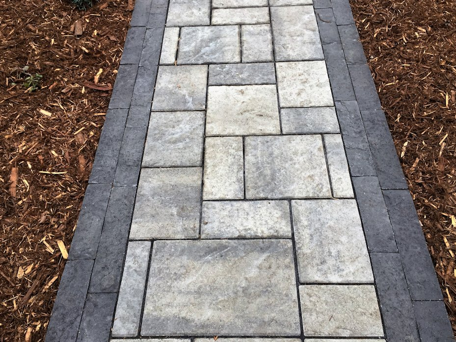 Note the pattern and complementary border on this paver path.