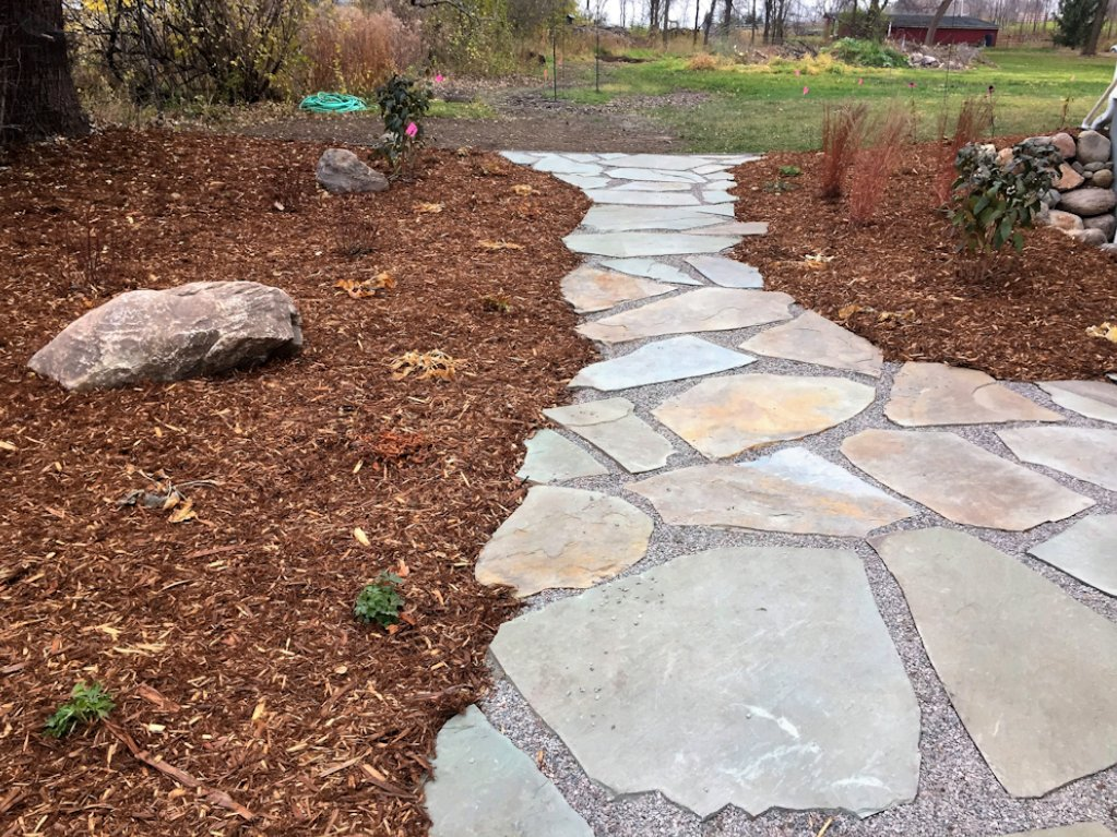 This stepped path is comprised of flagstone and gravel.