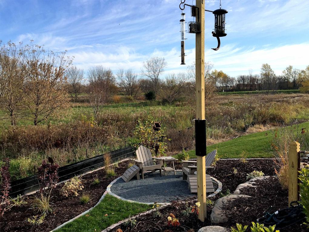 Custom bird feeders on terraced garden