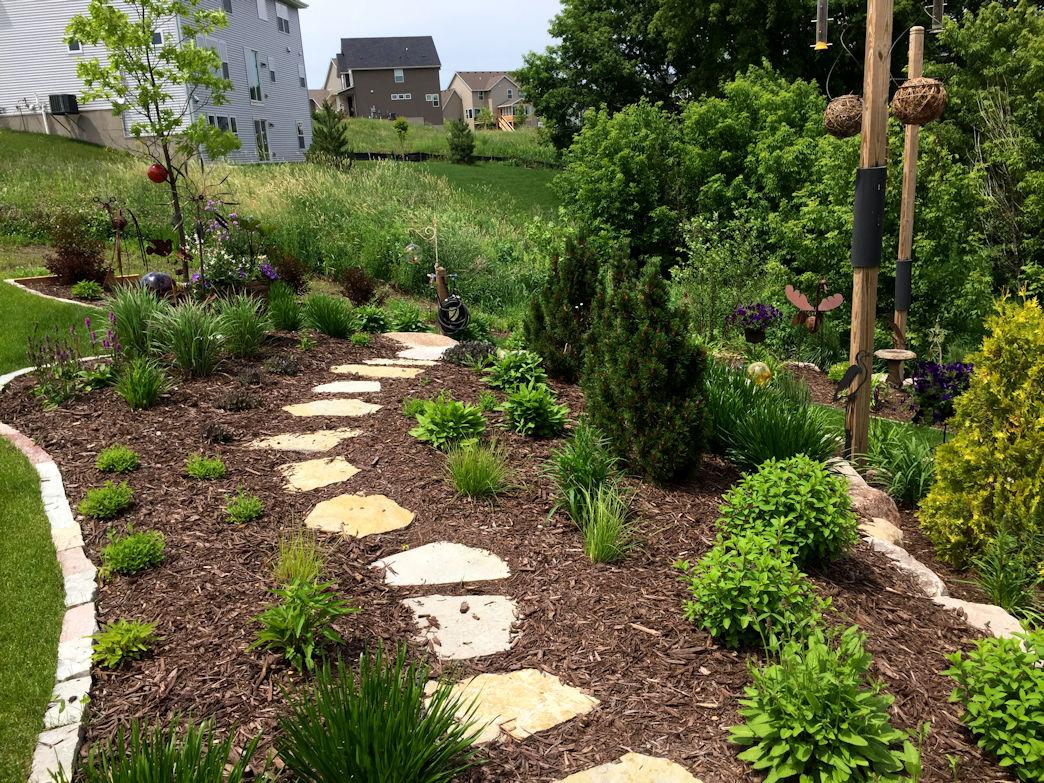 Flagstone walkway in terraced garden